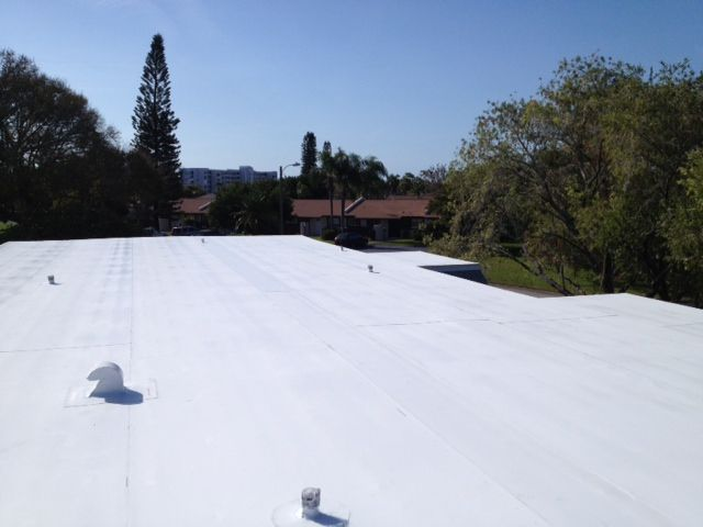 Commercial roof replacement for condo units in Kenneth City & Bradenton, FL